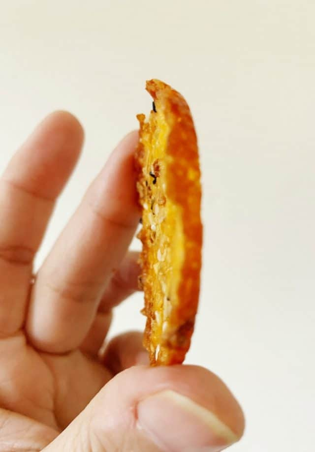 side view of everything seasoning cheese crisps