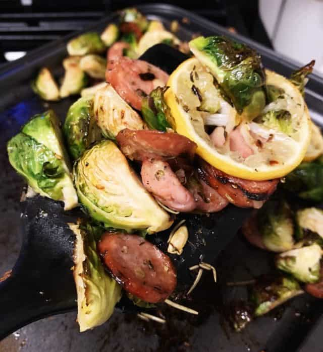serving of sausage and brussels sprouts sheet pan
