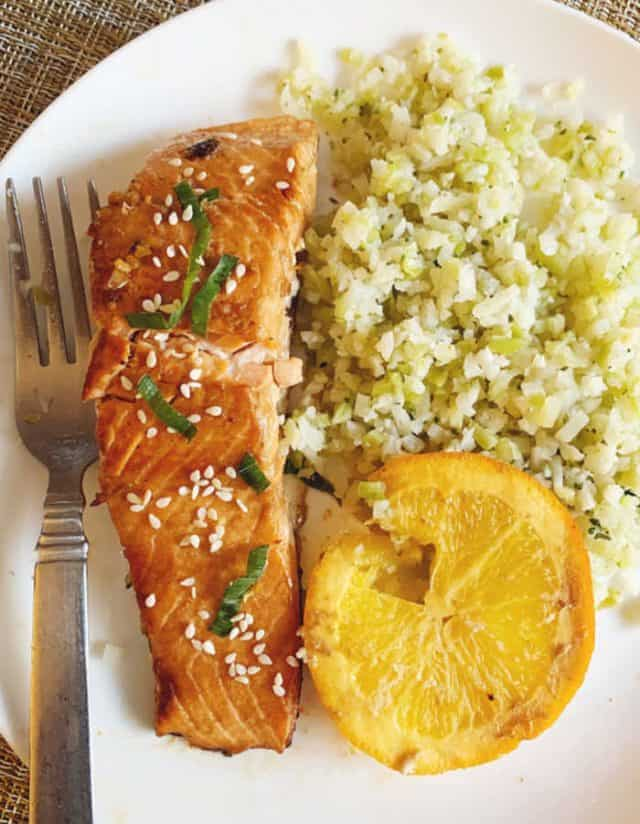 plate of salmon with cauliflower rice