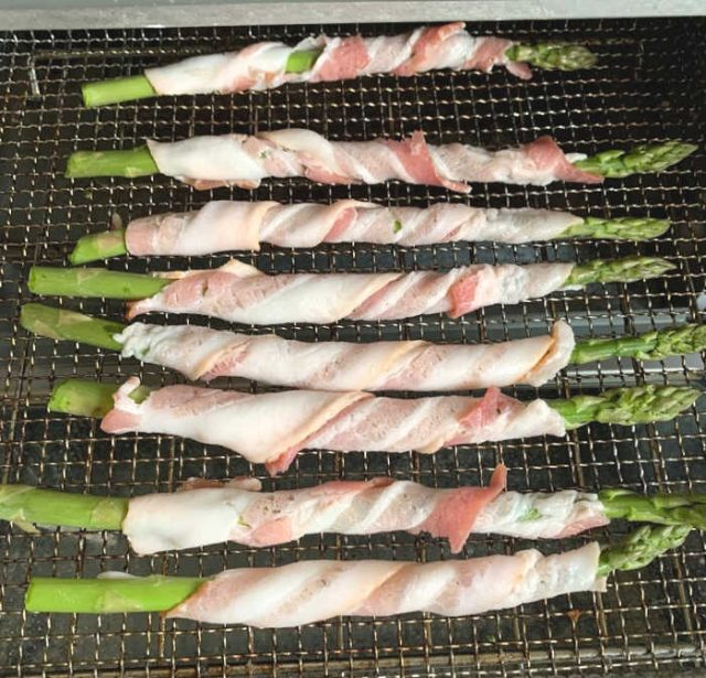 bacon wrapped asparagus on air fryer tray