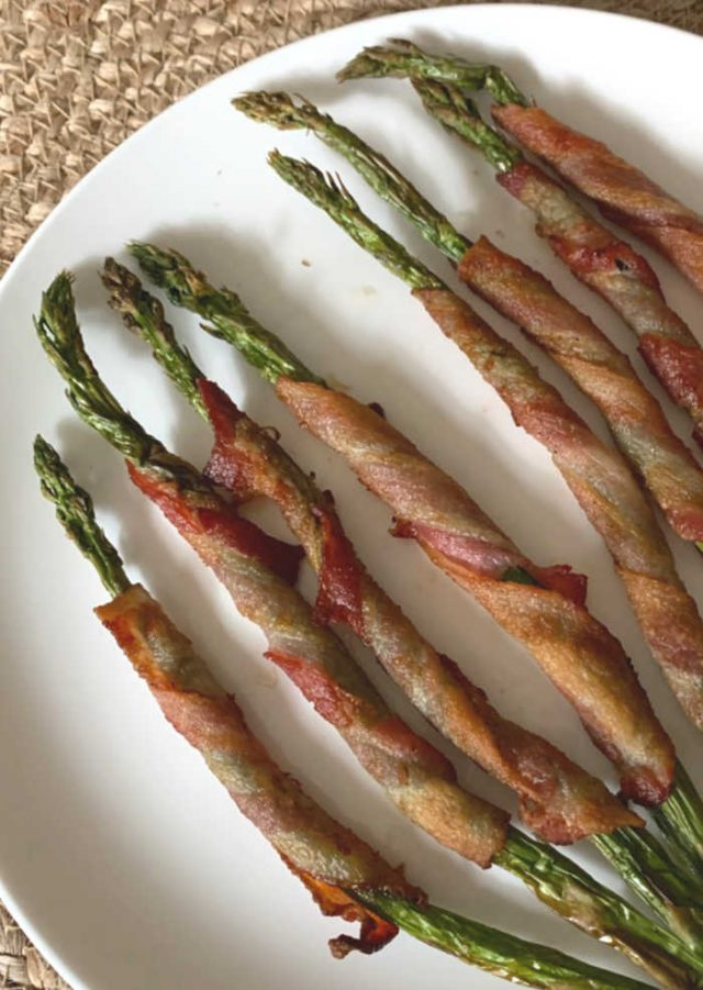 plate of asparagus wrapped in bacon