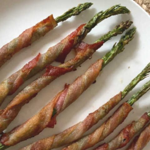 plate of asparagus wrapped in bacon horizontal